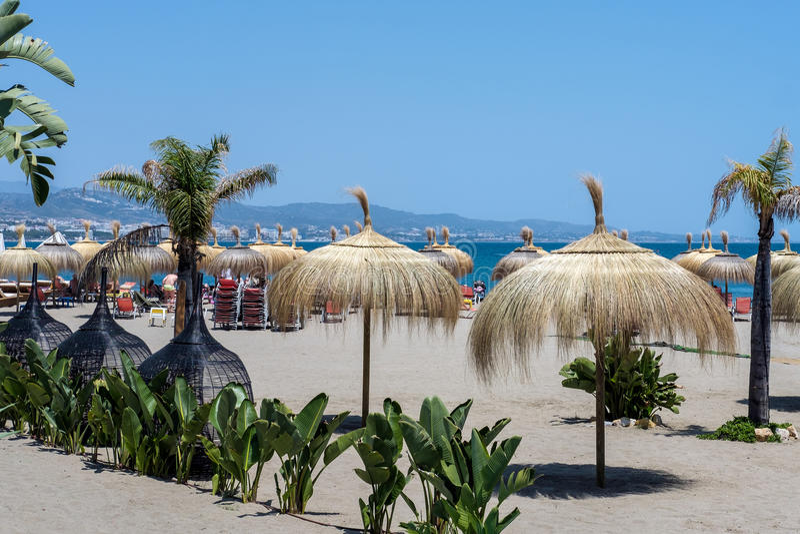 PUERTO BANUS ANDALUCIA/SPAIN - MAY 26 : Sun Umbrellas on the Beach at Puerto Banus Spain on May 26, 2016 royalty free stock photo