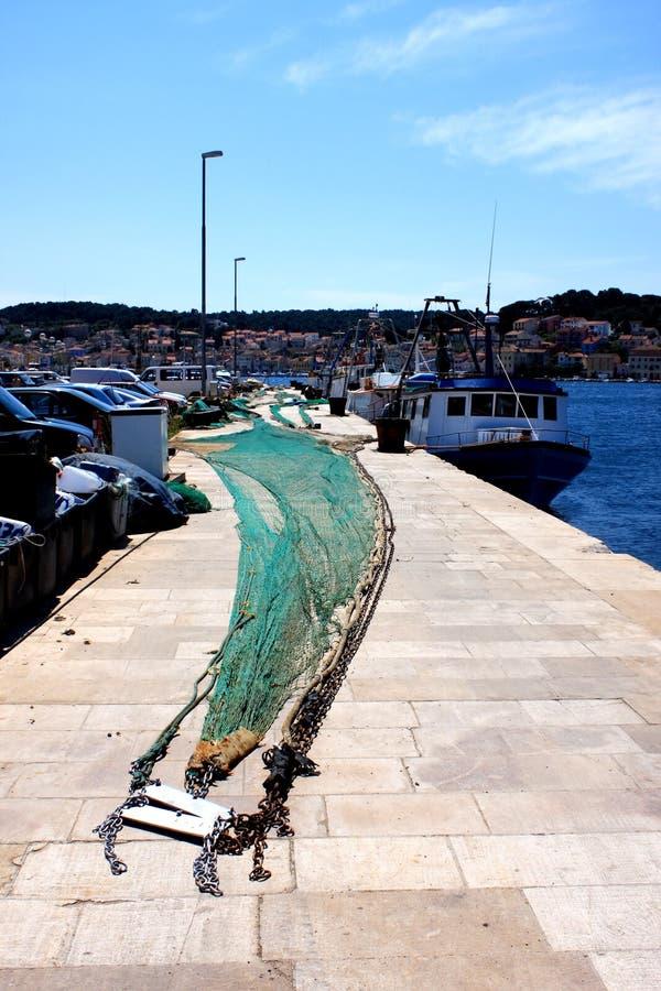 Puerto con la red de pesca foto de archivo libre de regalías