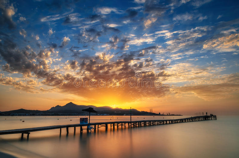 Puerto de Alcudia beach pier at sunrise in Mallorca, Balearic islands, Spain royalty free stock photography