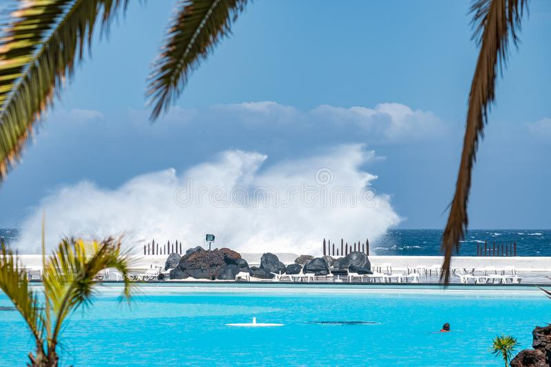 2019-03-21 Puerto de la Cruz, Santa Cruz de Tenerife. Wave at the swimming pool Martianez.  royalty free stock photos
