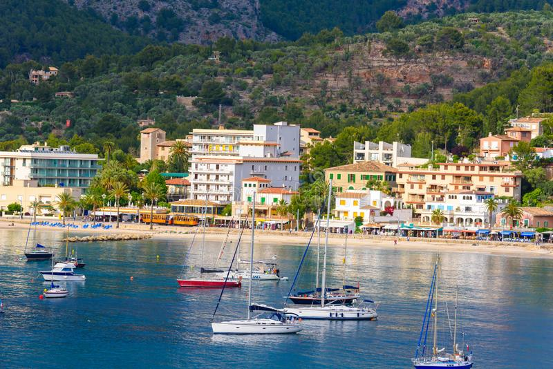 Puerto de Soller, Port of Mallorca island in balearic islands, Spain. Beautiful  beach and bay with boats in clear blue water of royalty free stock photo