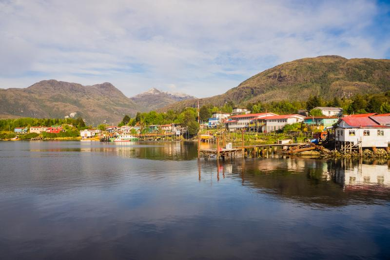 Panoramic view of Puerto Eden, south of Chile. Puerto Eden in Chilean fiords, Patagonia. Detail of the village of Puerto Eden in south of Chile, Pacific Ocean royalty free stock images