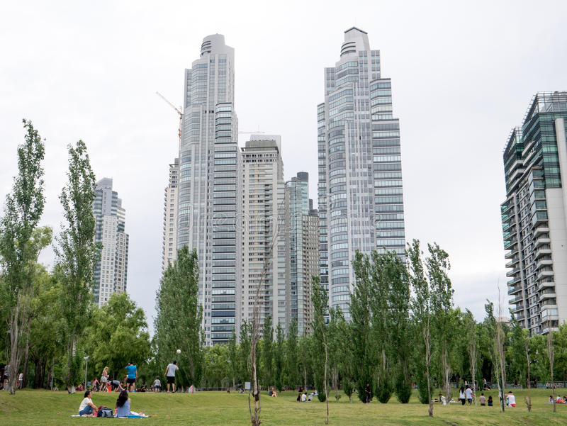 Puerto Madero neighborhood. BUENOS AIRES, ARGENTINA - DECEMBER 02, 2016: People enjoy the park next to Skyscrapers in Puerto Madero neighborhood, Buenos Aires stock photography