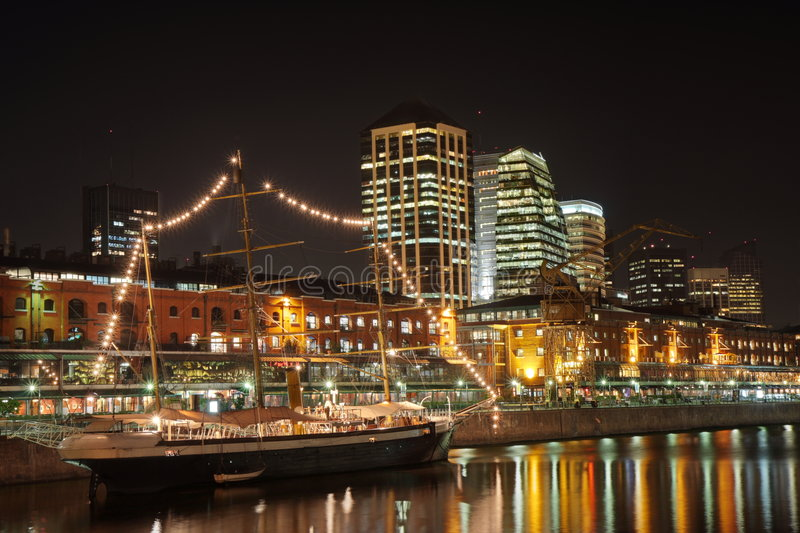 Puerto Madero at night. Night view of Puerto Madero district, Buenos Aires (Argentina) with the sailing yacht Corbeta Uruguay, a waterfront restaurant complex at royalty free stock photo