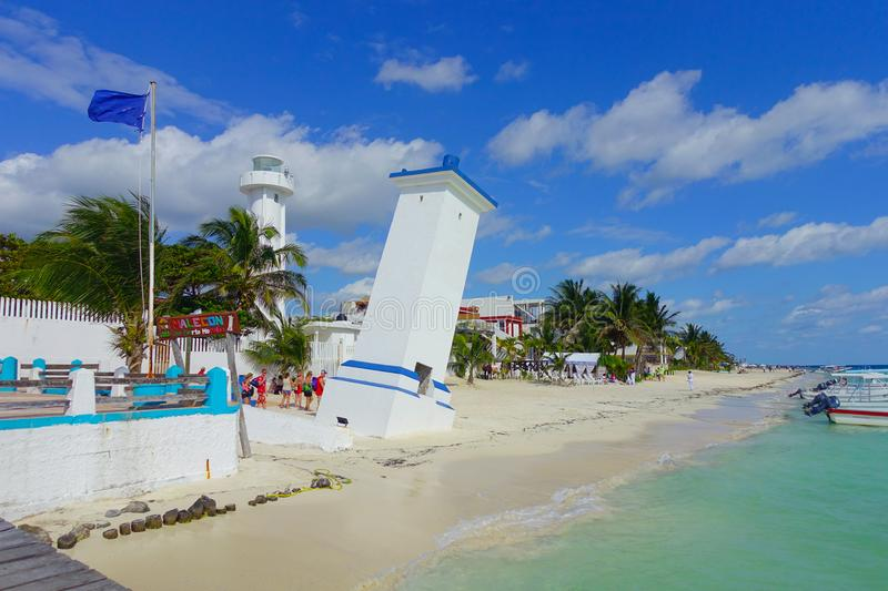 Puerto Morelos, Mexico - January 10, 2018: Unidentified group of people walking at outdoors of old bent lighthouse in royalty free stock photo