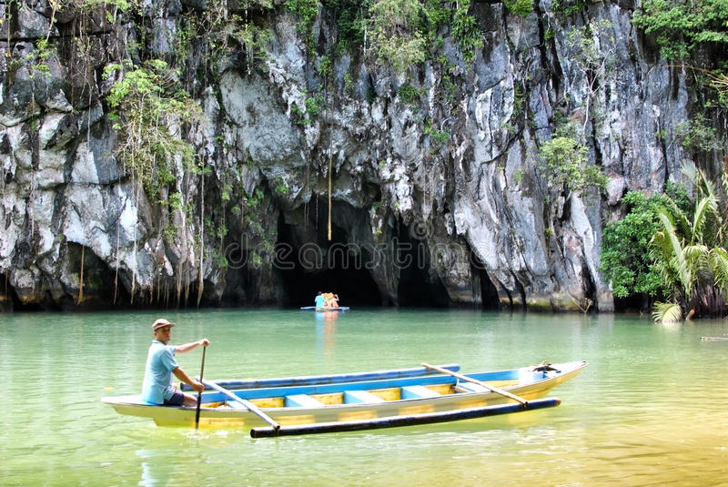 Puerto Princesa St. Paul Subterranean River. One of the 7 New Wonders of the World, located in Puerto Princesa, Palawan of the Philippines. A boatman and a boat stock image