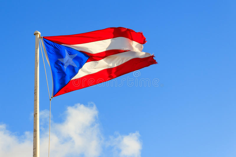 Puerto Rican flag against a blue sky royalty free stock images