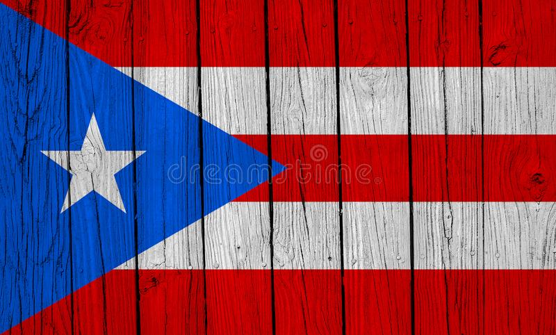 Puerto Rico Flag Over Wood Planks. A grunge Puerto Rico flag over wood planks royalty free stock photography