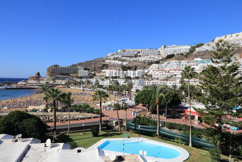 Puerto Rico (Gran Canaria. GRAN CANARIA, SPAIN - DECEMBER 2, 2015: People visit Puerto Rico Beach in Gran Canaria, Spain. Canary Islands had record 12.9 million royalty free stock images