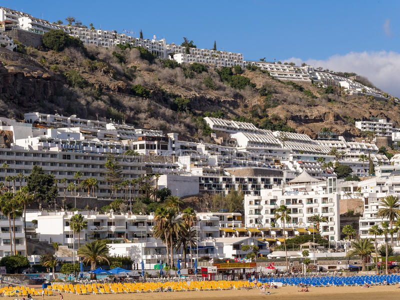 Puerto Rico Holiday Resort Gran Canaria Spain. Beach with sunbeds overlooked by hillside apartments in the holiday resort of Puerto Rico. Gran Canaria, Canary stock images