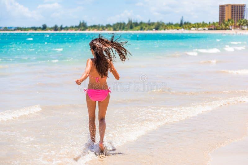 Puerto Rico San Juan beach bikini woman having fun splashing water at Isla Verde resort. People on summer holiday in famous royalty free stock images