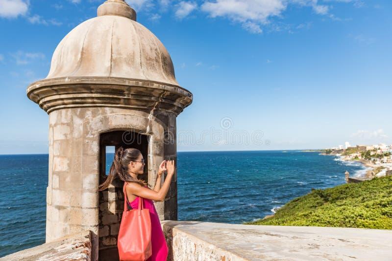 Puerto Rico San Juan woman taking phone pictures of Old San Juan Fort Castillo San Felipe Del Morro. Asian tourist people royalty free stock image