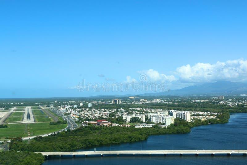 Puerto Rico from the sky. Aerial photograph of San Juan airport landing, Puerto Rico. San Juan Airport, known officially as San Juan Luis Muñoz Marín stock image