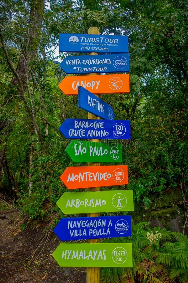 PUERTO VARAS, CHILE, SEPTEMBER, 23, 2018: Outdoor view of informative sign of canopy, rafing and information of distance royalty free stock photo