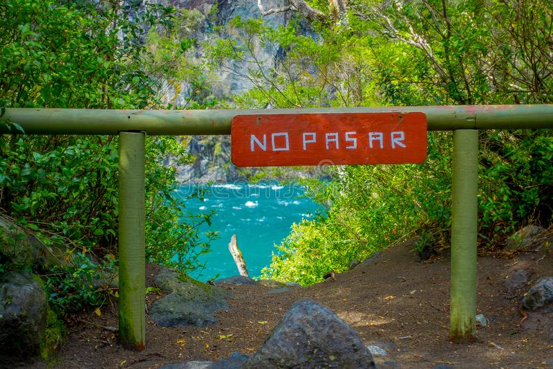 PUERTO VARAS, CHILE, SEPTEMBER, 23, 2018: Outdoor view of informative sign of not trespassing written in wooden royalty free stock photography