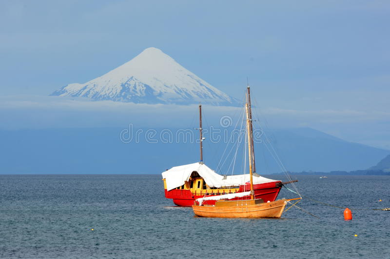 Puerto Varas, Chile. Small boats on the lake Llanquihue, with bottom of the Osorno Volcano stock image