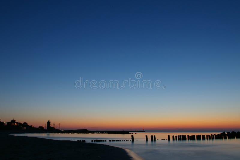 Puesta del sol azul y anaranjada lisa. imágenes de archivo libres de regalías