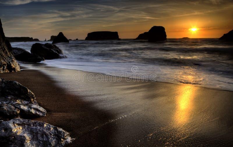 Puesta del sol Bandon Oregon fotos de archivo