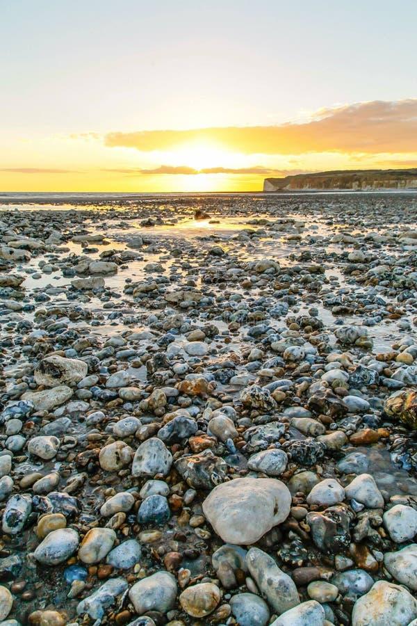 Puesta del sol BRITÁNICA de la playa imágenes de archivo libres de regalías