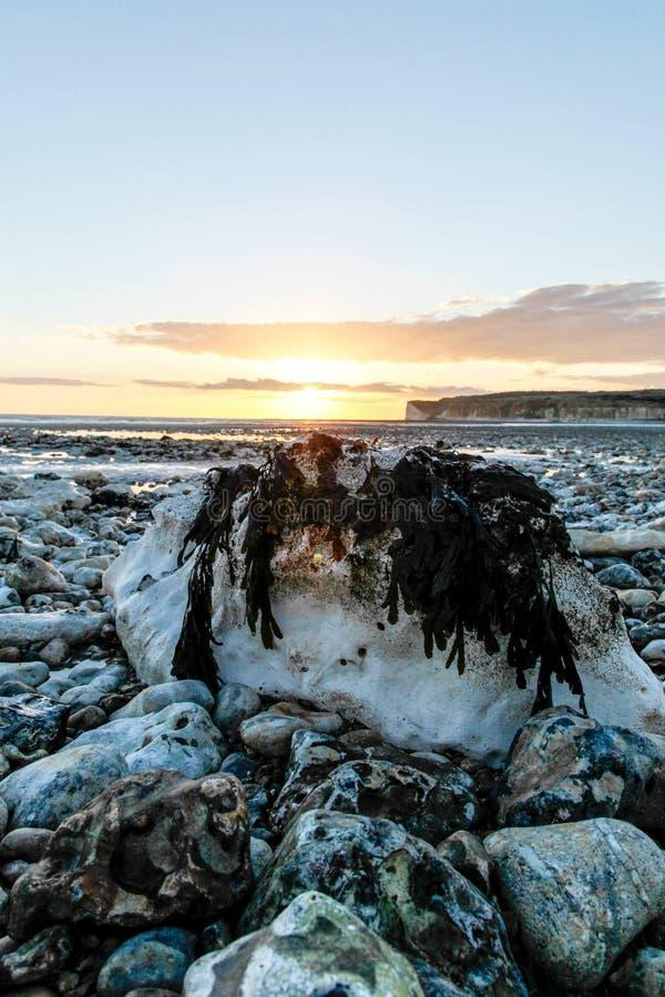 Puesta del sol BRITÁNICA de la playa foto de archivo libre de regalías