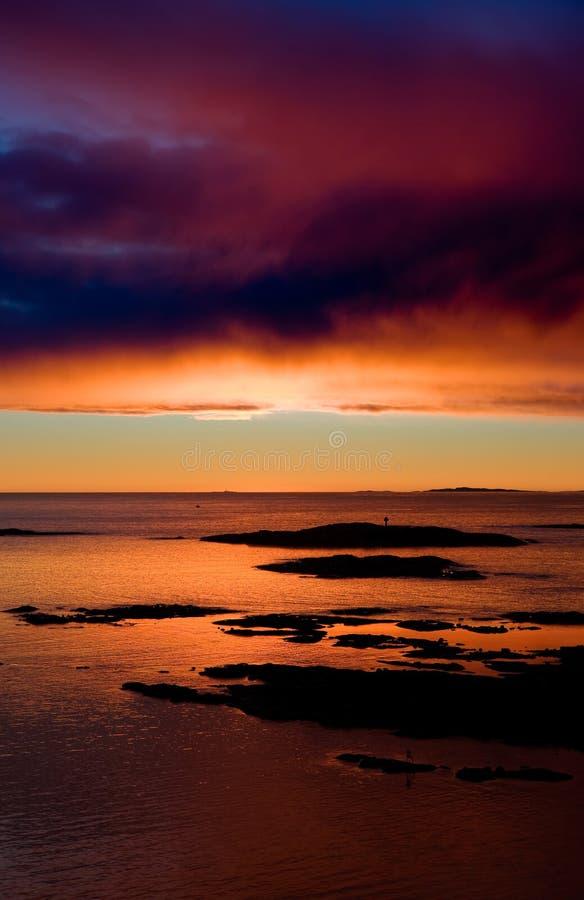 Puesta del sol caliente del océano fotografía de archivo