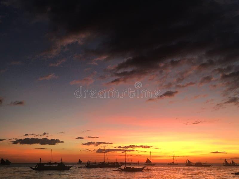 Puesta del sol coloreada multi fotos de archivo
