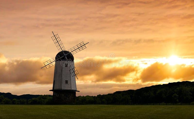 Puesta del sol con el molino de viento fotografía de archivo