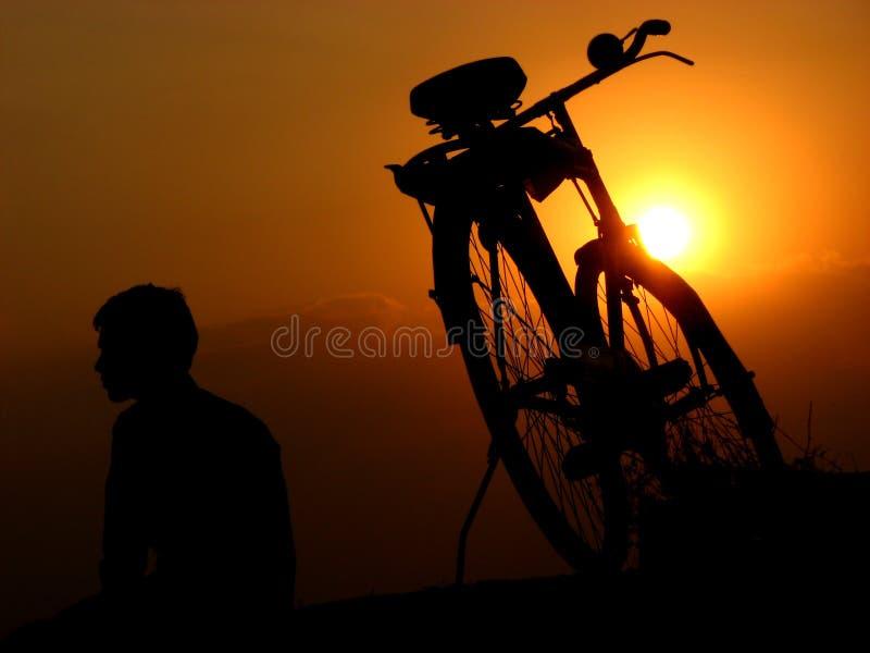 Puesta del sol de ciclo fotografía de archivo