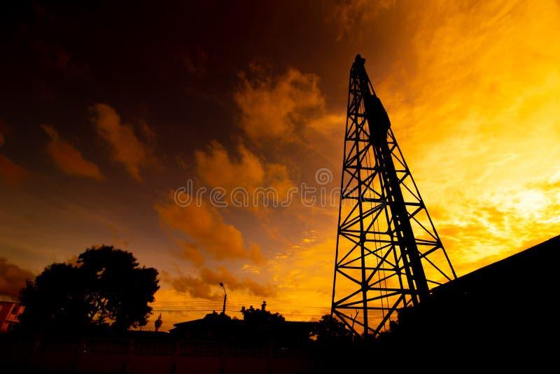 Puesta del sol de Derrick Pile At foto de archivo libre de regalías