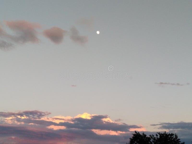 Puesta del sol de la Luna Llena imagen de archivo