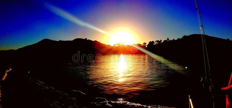 Puesta del sol de la pesca fotografía de archivo libre de regalías