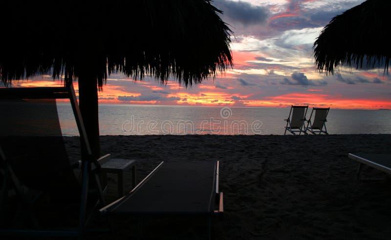 Puesta del sol de la playa fotos de archivo