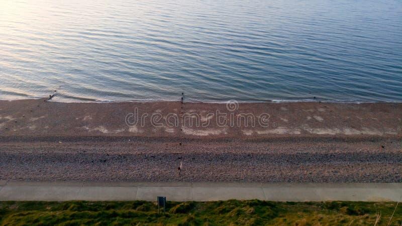 Puesta del sol de la playa de Reculver imagen de archivo