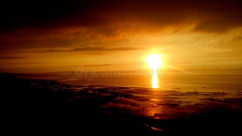 Puesta del sol de la playa de Reculver fotos de archivo