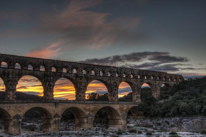 Puesta del sol de Ponte du Gard fotografía de archivo