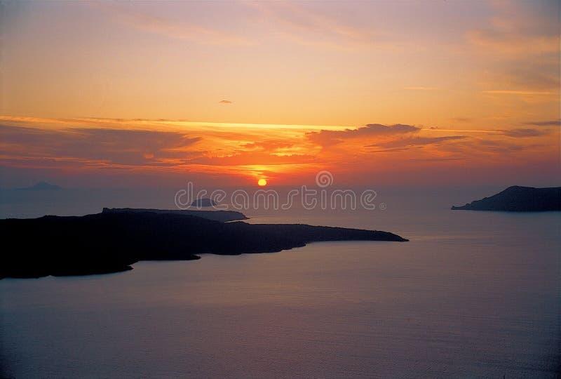 Puesta del sol de Santorini fotos de archivo