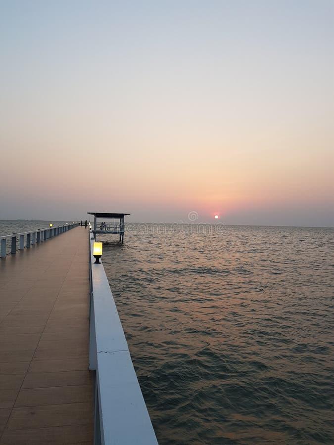 Puesta del sol del arena de mar fotografía de archivo