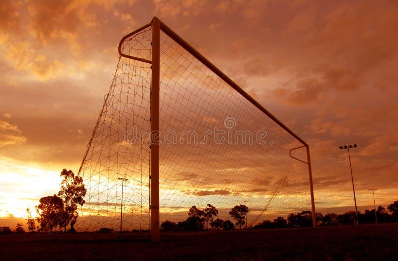 Puesta del sol del fútbol fotografía de archivo libre de regalías