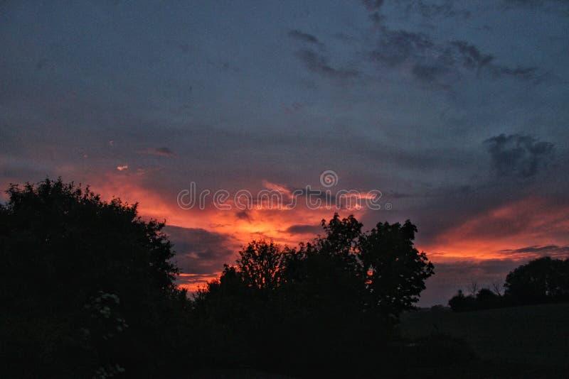 Puesta del sol del fuego fotografía de archivo