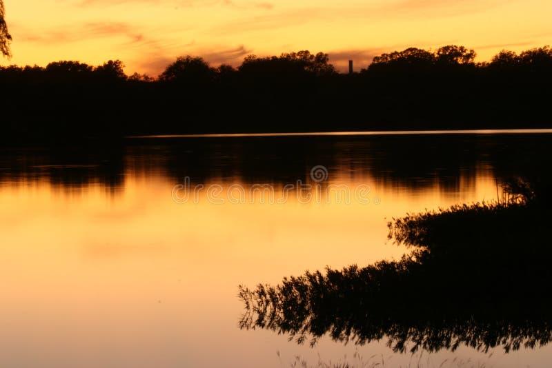 Download Puesta del sol del lago foto de archivo. Imagen de tejas - 7151940