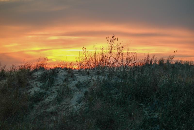 Puesta del sol el lago Michigan de las dunas de arena fotografía de archivo libre de regalías