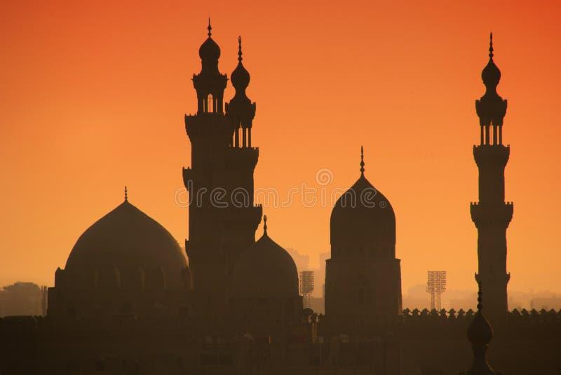 Puesta del sol en alminares de El Cairo fotografía de archivo