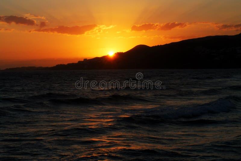 Puesta del sol en Costa del Sol fotos de archivo