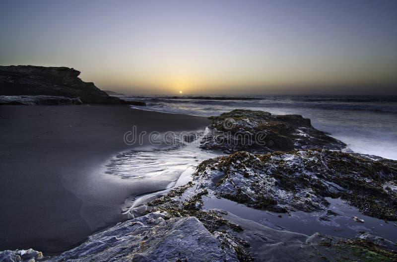 Puesta del sol en Curanipe, Chile imagen de archivo