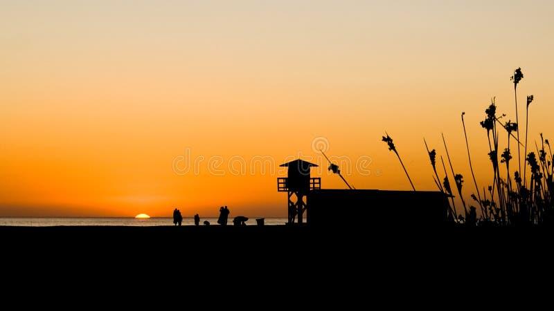 Puesta del sol en el la Frontera de Conil de imagenes de archivo