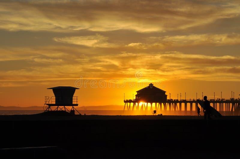 Puesta del sol en Huntington Beach fotografía de archivo libre de regalías