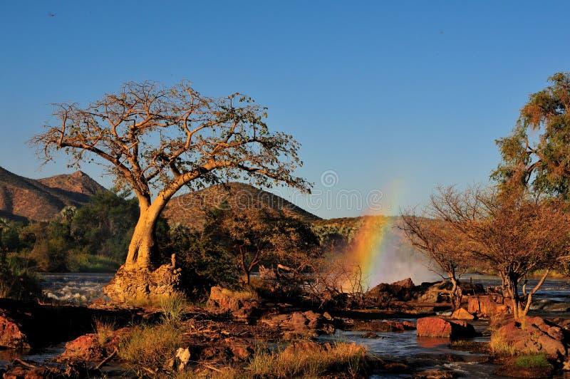 Puesta del sol en la cascada de Epupa, Namibia imagenes de archivo