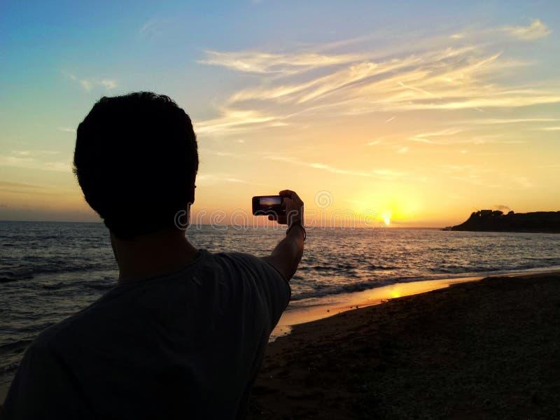 Puesta del sol en la imagen fotografía de archivo libre de regalías