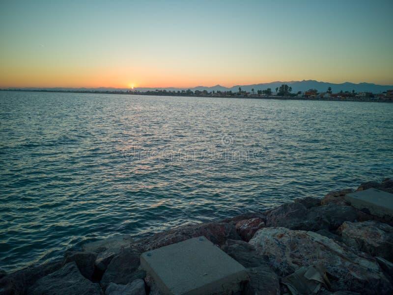 Puesta del sol en la playa de Burriana fotografía de archivo libre de regalías