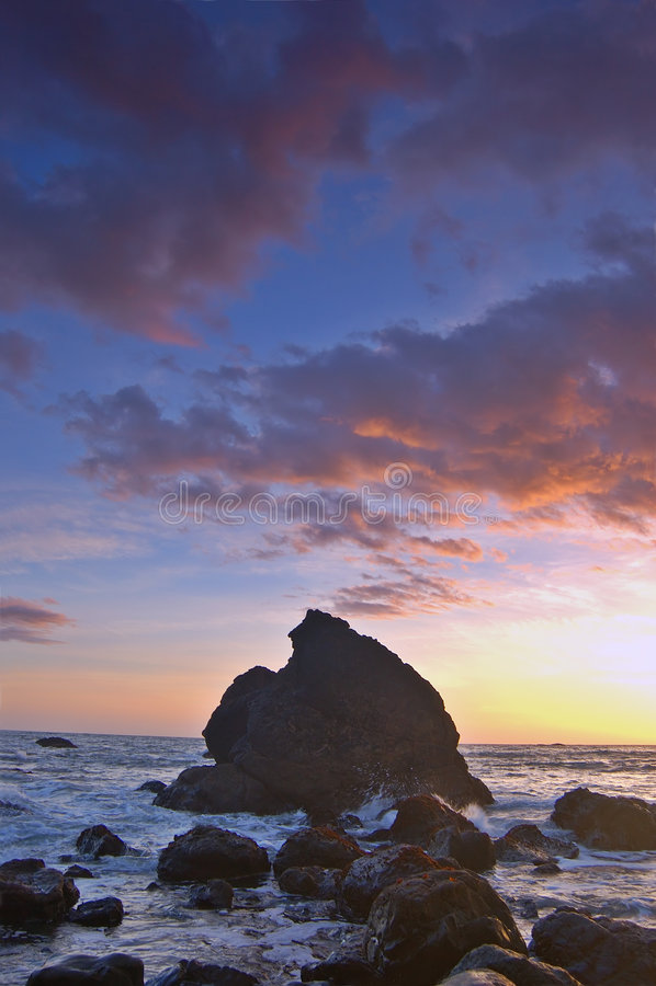 Puesta del sol en la playa de Muir foto de archivo
